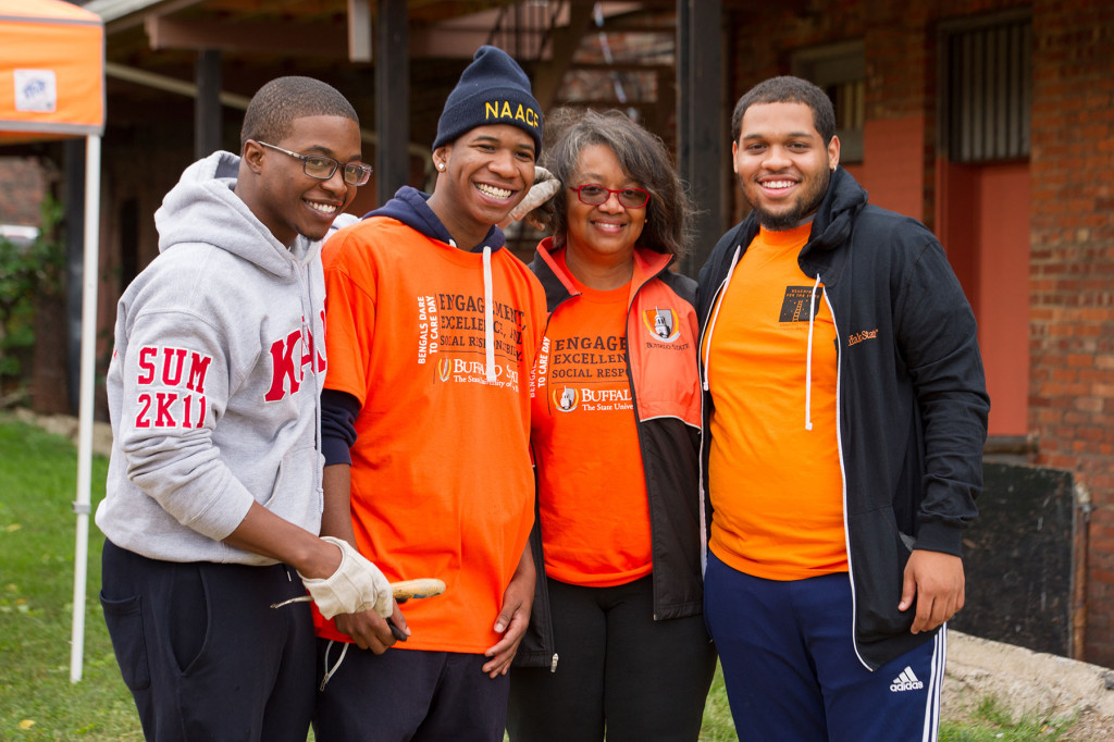 SUNY Buffalo State president Dr. Katherine Conway-Turner poses with students outside during Dare to Care Day.