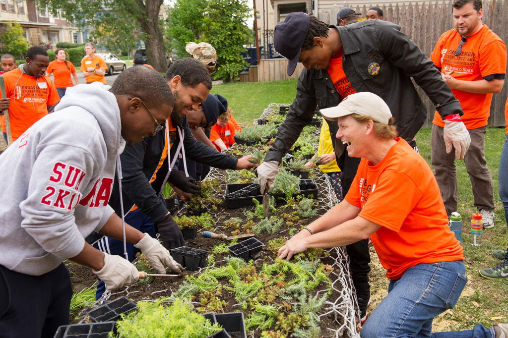 Buffalo State professor and student volunteers at the Grant Street Neighborhood Center Pocket Park Project.
