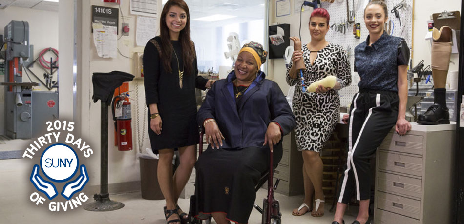 A military veteran sits in wheelchair wearing an outfit designed by FIT students.