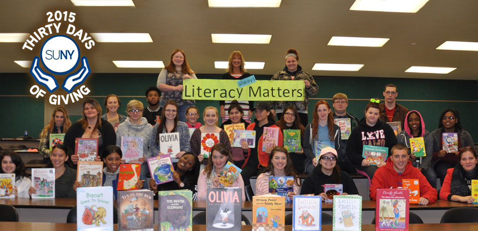 Fulton Montgomery Community College students with book donations during Literacy Matters campaign