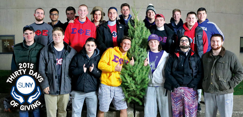 SUNY Fredonia students stand around a Christmas Tree after their annual Tree Troy for Big Brothers Big Sisters