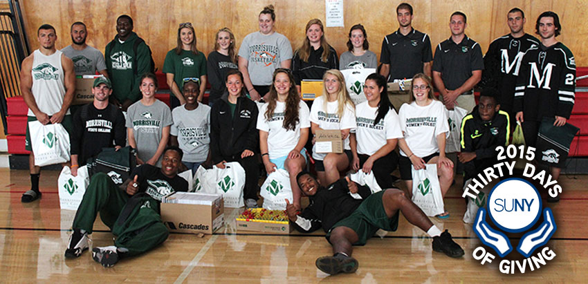 Morrisville State College students pose in gym during a Back To School charity drive.