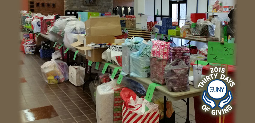 Oneonta Giving Tree event with gifts on tables.