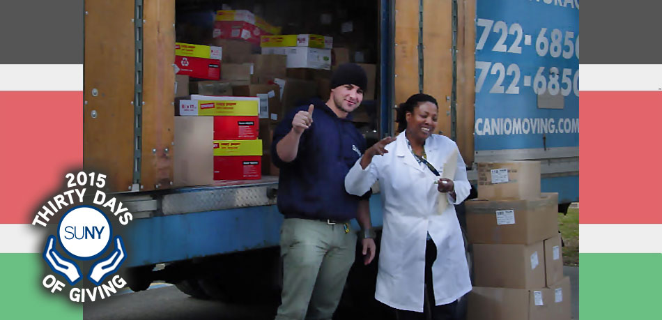SUNY Ulster Professor Mkajuma Mbogho and student ready the books for shipping to Kenya.