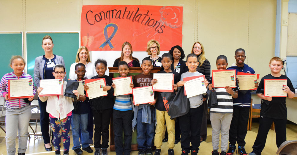 Farmingdale State College professor Monica Caravella poses with Tangier Smith Elementary School