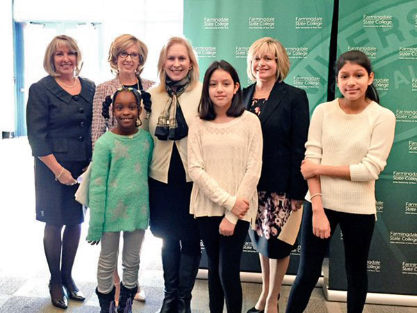 Farmingdale Staff pose with Senator Kirsten Gillibrand at an elementary school