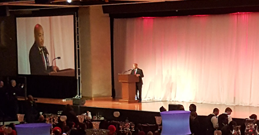 Speaker Carl Heastie address crowd at Black and Puerto Rican caucus event before recognizing EOP student success.