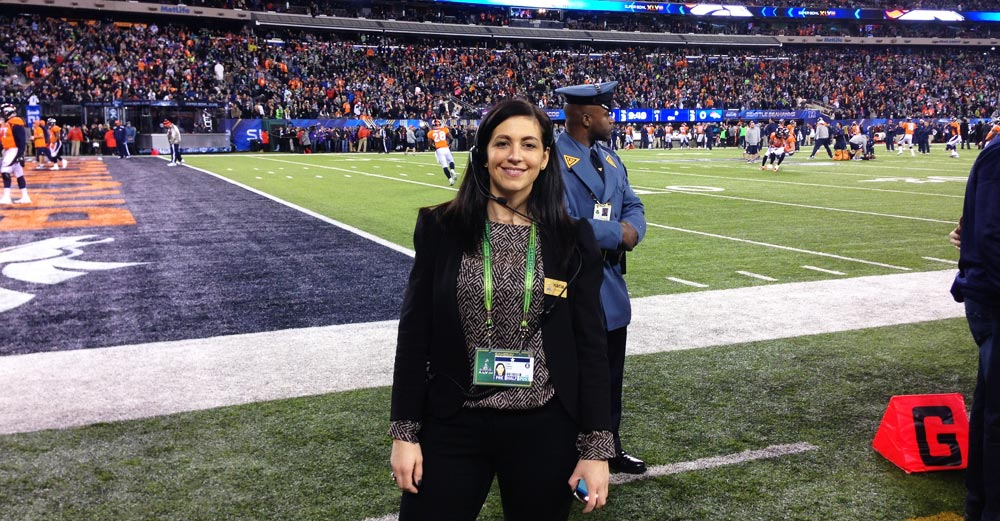 Katie Keenan, SUNY Cortland class of 2005, stands on the sidelines at Super Bowl 48.