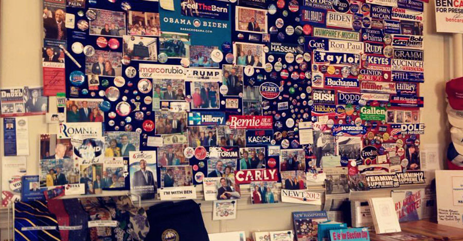 Presidential candidate stickers on an office wall in New Hampshire.