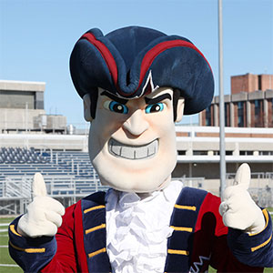 Privateer Pete of SUNY Maritime on football field.