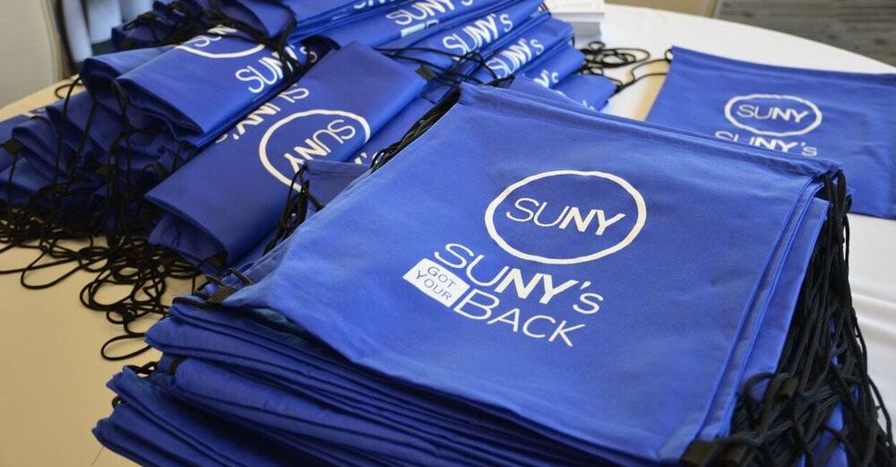 SUNY's Got Your Back backpacks on table.