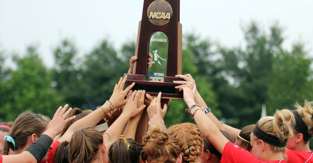 SUNY Cortland softball team holding up NCAA championship 4th place trophy