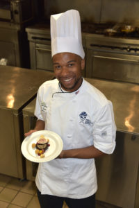 Parris Sewer, captain of SUNY Delhi's culinary team, with their award-winning dessert.