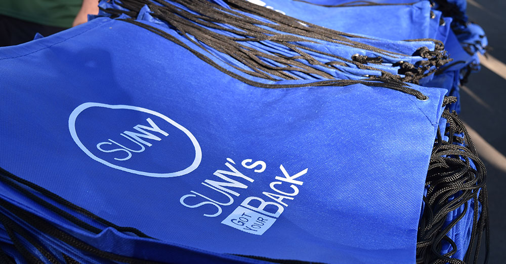 SUNY's Got Your Back bags on a table outdoors at The Barclays event.