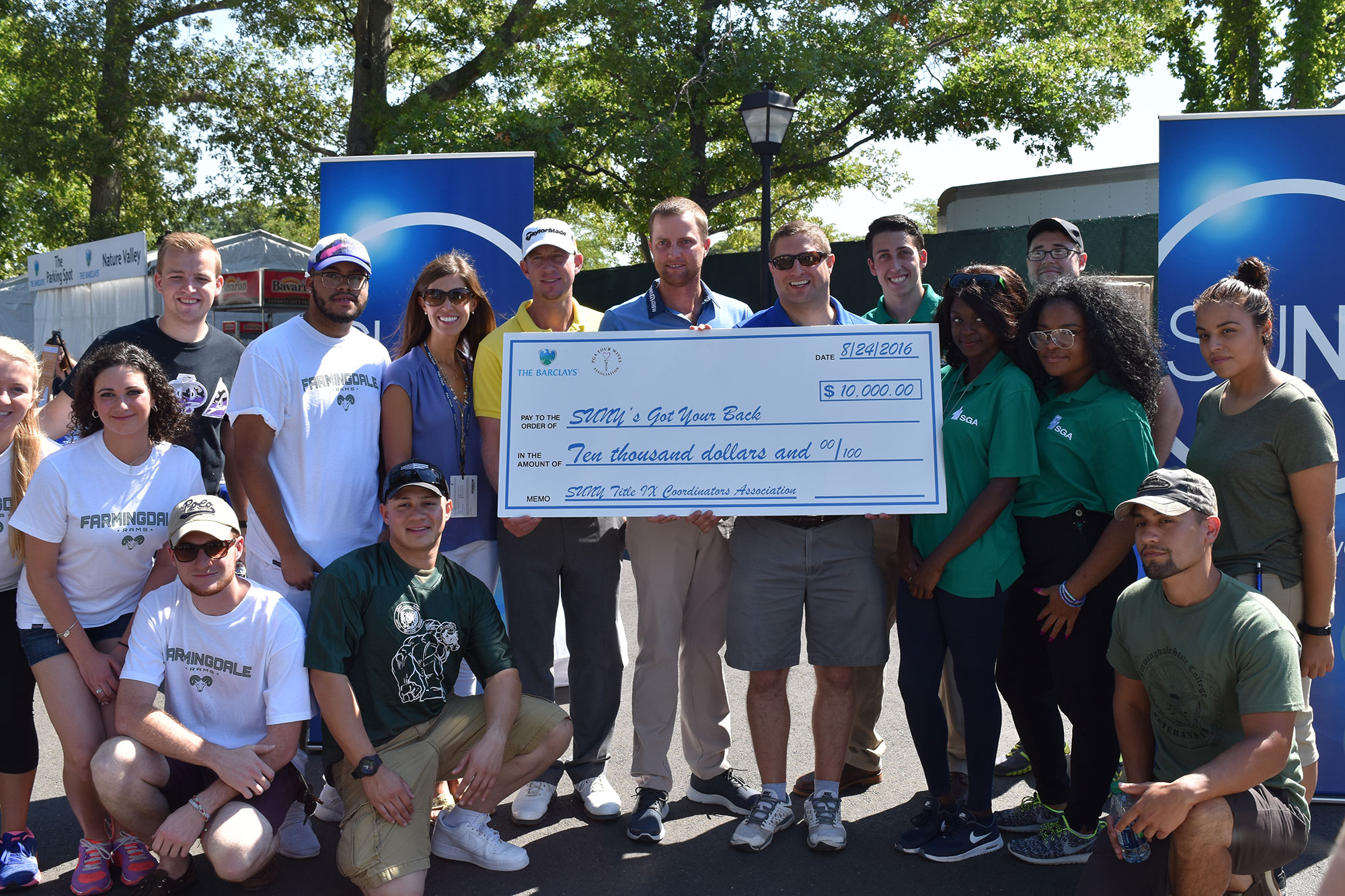 A large check is presnted to the SUNY 's Got Your Back volunteers at The Barclays.