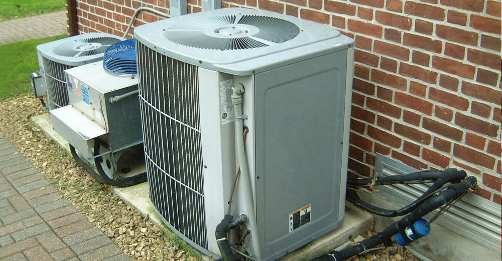 Home air conditioning unit outside a house.