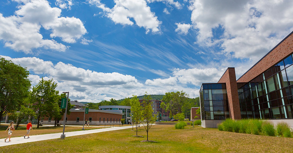 Binghamton University campus under sun-filled sky