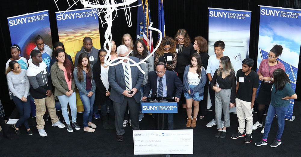 Elementary school students at SUNY Poly's CNSE in Albany receive Be the Change for Kids Awards with the New York State School Boards Association.