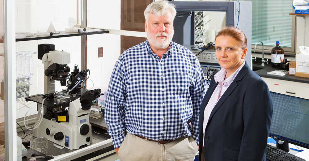 Randall Rasmusson and Glenna Bett of UBuffalo in science lab.