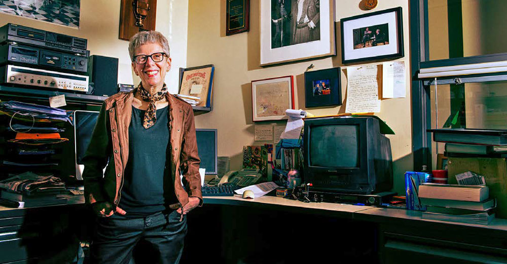 Terry Gross stands inside her radio studio.
