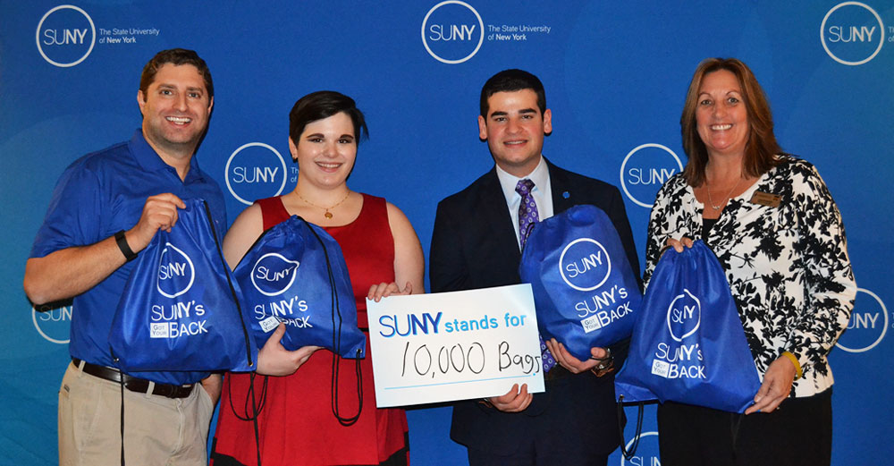 Joseph Storch, SUNYSA Vice President Bridget Doyle, SUNYSA President Marc Cohen, and SUNY Oswego's Lisa Evaneski stand with the 10,000th bag filled for SUNY's Got Your Back.