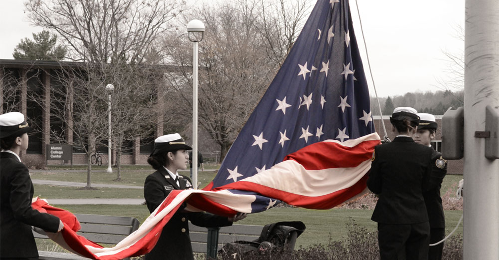 MVCC military sstudents raising an american flag.