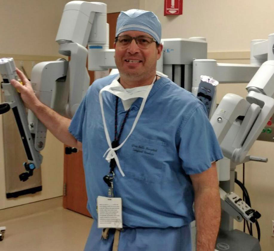 Mike Sylvain in front of hospital equipment.