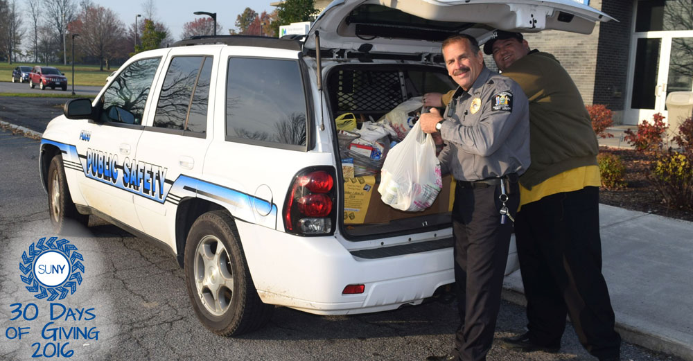 FMCC officer takes food donations out of SUV squad car.