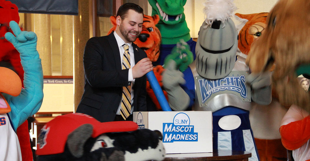 Tom Mastro pulls the lever to kick off 2016 Mascot Madness at the state capital.