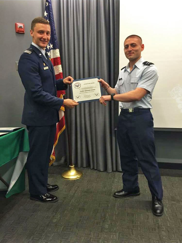 Farmingdale ROTC student receives a certificate in uniform.