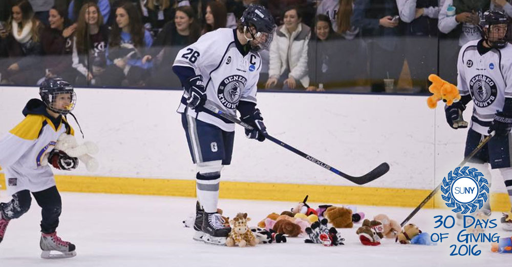 SUNY Geneseo hockey players gather stuffed animals on the ice during the Teddy Bear Toss.