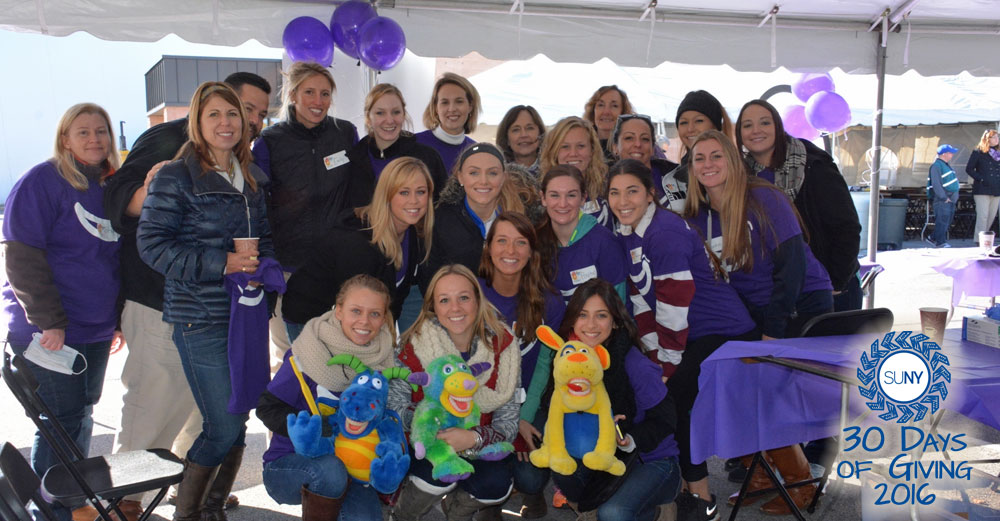 Faculty and students of the Dental Hygiene Department at Hudson Valley Community College pose in purple gear.