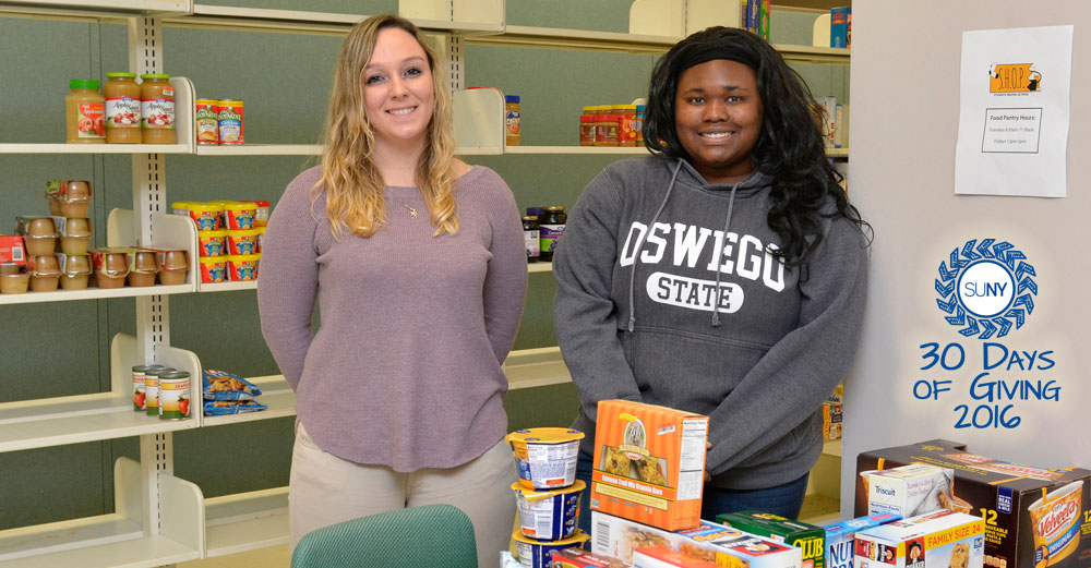 2 female volunteers in the Students Helping Oz Peers (S.H.O.P.) pantry.