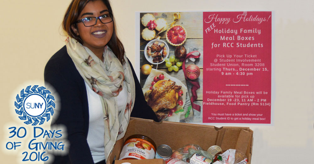 Elizabeth Perez of Student Involvement at Rockland Community College assists with distribution of holiday food boxes for students.
