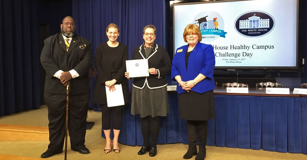 Monroe Community College at the White House Healthy Campus recognition day include student Leon Rice, MCC President Anne M. Kress and Jeanne Flanagan, RN, MCC Health Services.