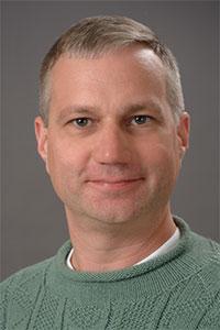 Casey Raymond, Oswego professor, headshot