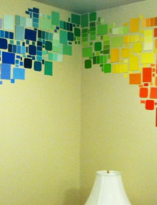 Paint swatch cards on wall in design form.