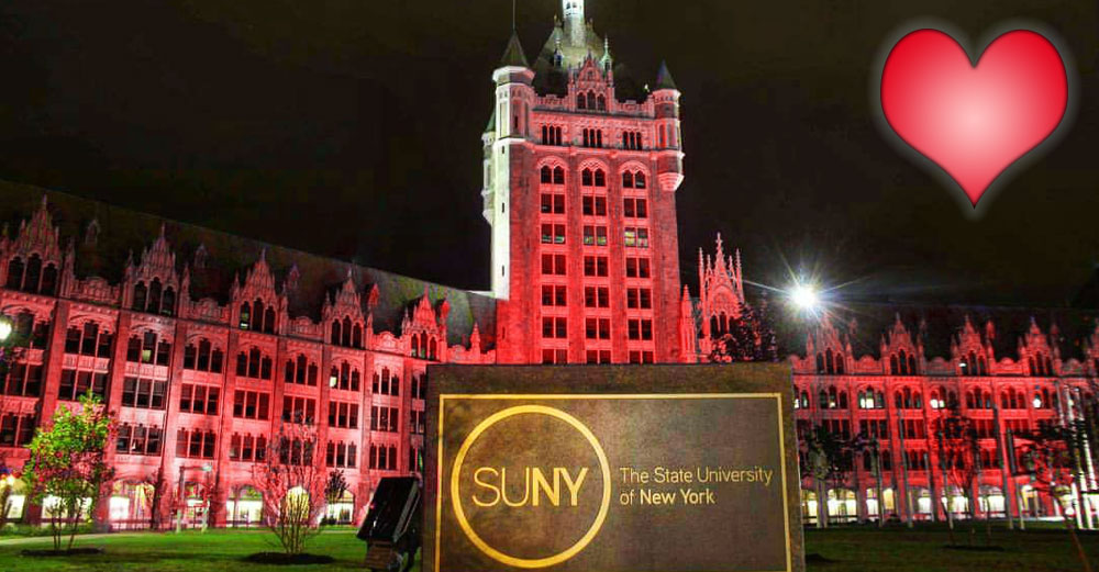 SUNY Plaza shines in red light at night.