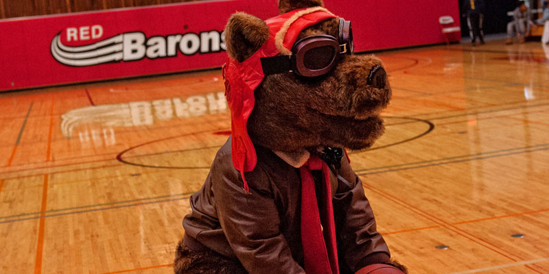 Corning Community College mascot Red Baron in basketball arena