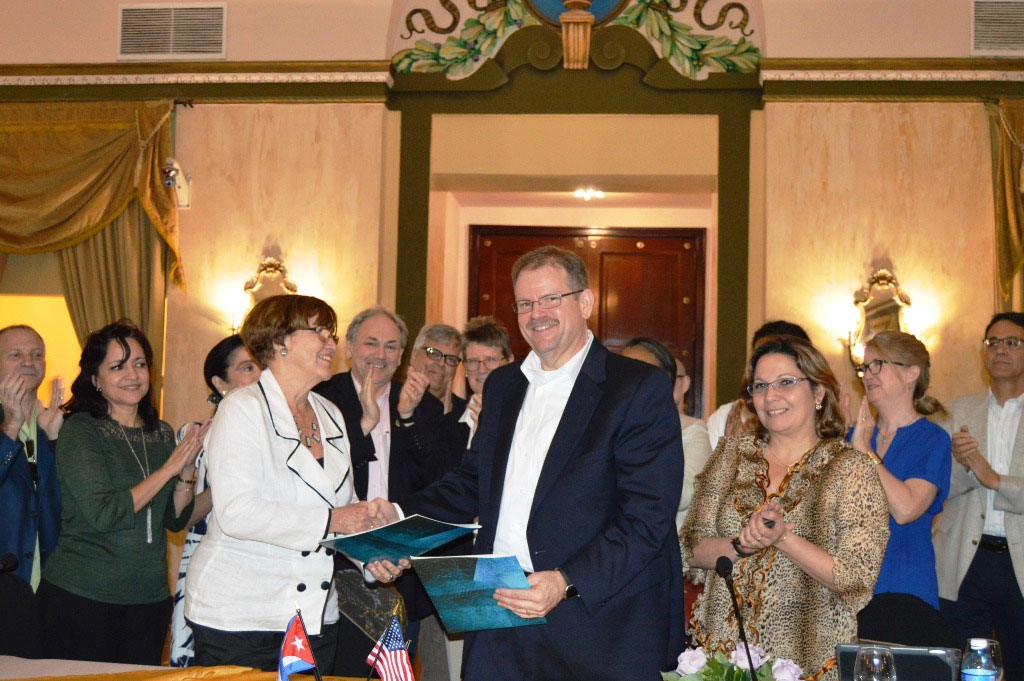 Provost Alexander Cartwright with a Cuban education minister after signing the MOU in Havana.