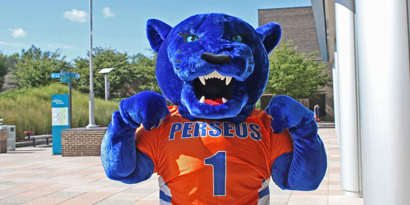 Perseus Panther flexes outside a SUNY Purchase campus building.
