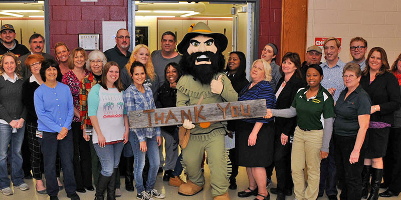 CGCC mascot RIP Van Winkle holds Thank YOu sign with many students and faculty.