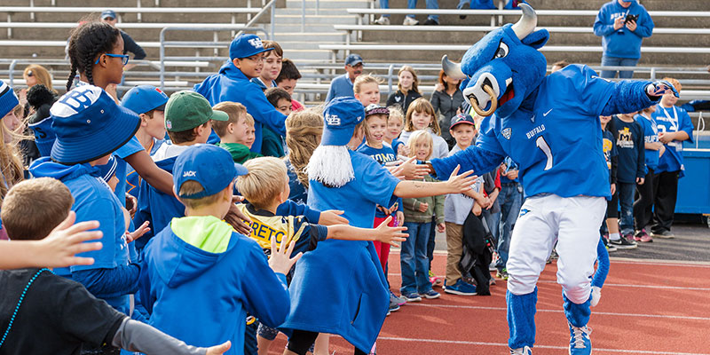 Victor E Bull of UB meeting his young fans on the field