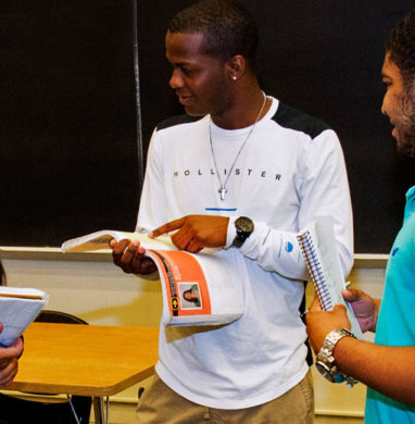 3 EOP students in a UAlbany classroom.