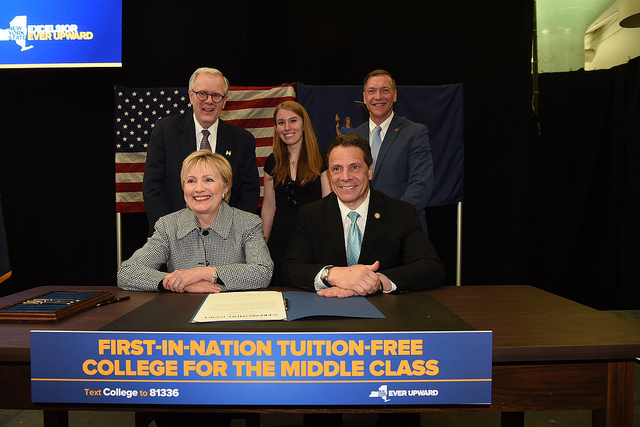 Governor Cuomo, Hillary Clinton, Stony Brook President Stanley and others at the signing of the Excelsior Scholarship into law.