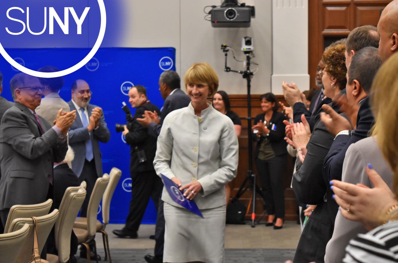 Newly appointed chancellor Kristina M Johnson walks to the podium to give her first remarks.