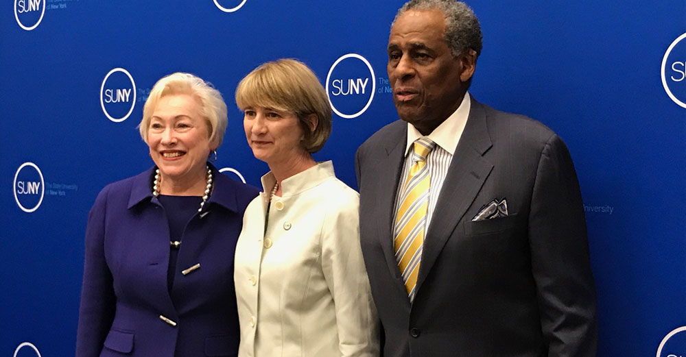 Newly elected Chancellor of SUNY Kristina M Johnson stands between Chancellor Nancy Zimpher and Board Chairman Carl McCall