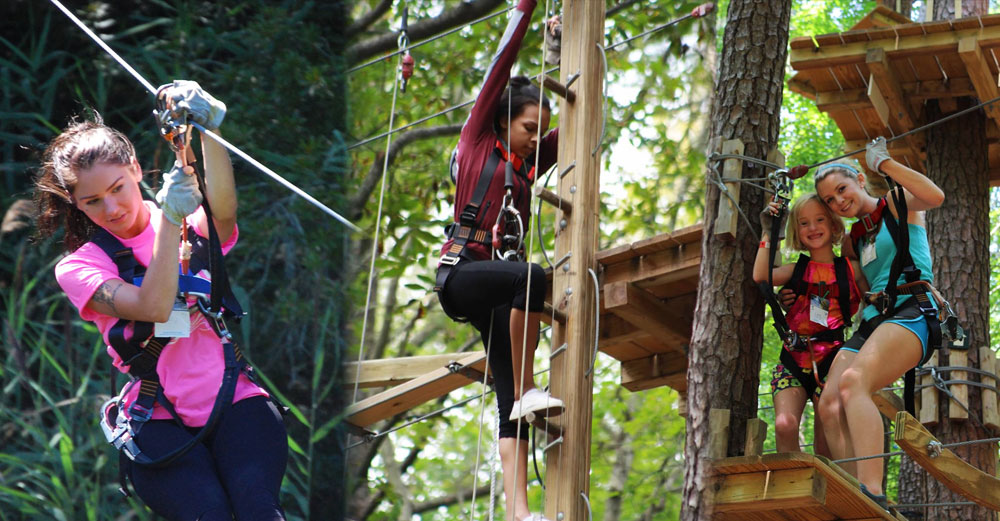People ride the zip line through the trees at Adeventure Park on Long Island.