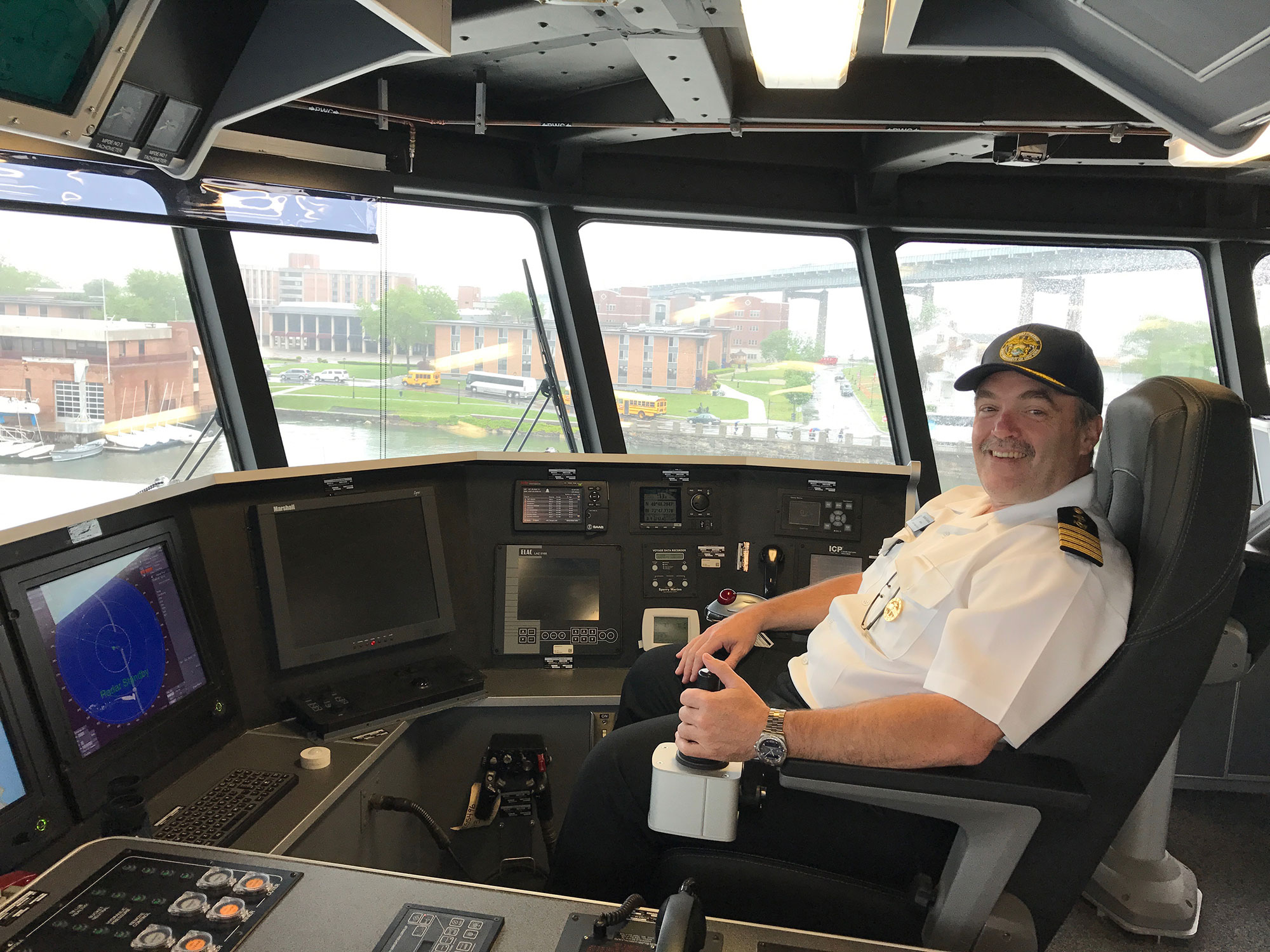 Capt. David Gommo of SUNY Maritime at the helm of the USNS Yuma ship, docked at the Maritime campus.