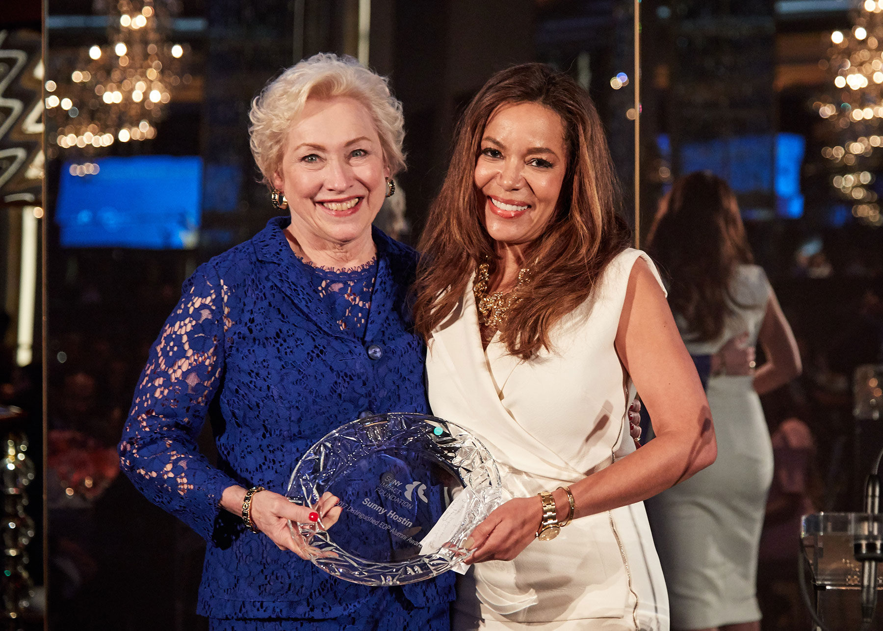 SUNY chancellor Nanzy Zimpher stands with The View co-host Sunny Hostin as they hold the Distinguished EOP Alumni award.